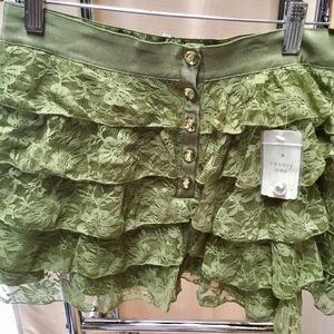 New with tags, adorable green lace skirt.